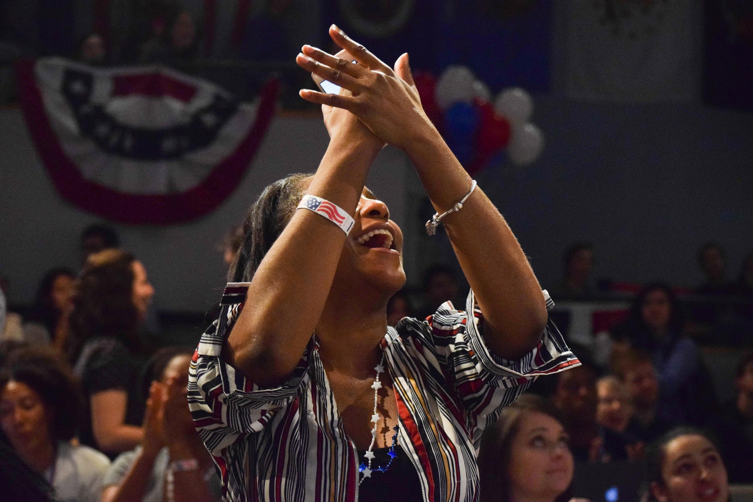 Sade A. Abraham, a Graduate School of Education alum, cheers upon hearing CNN report that Texas U.S. Senate candidate Beto O'Rourke was pulling ahead. O'Rourke ultimately lost to incumbent Ted Cruz.