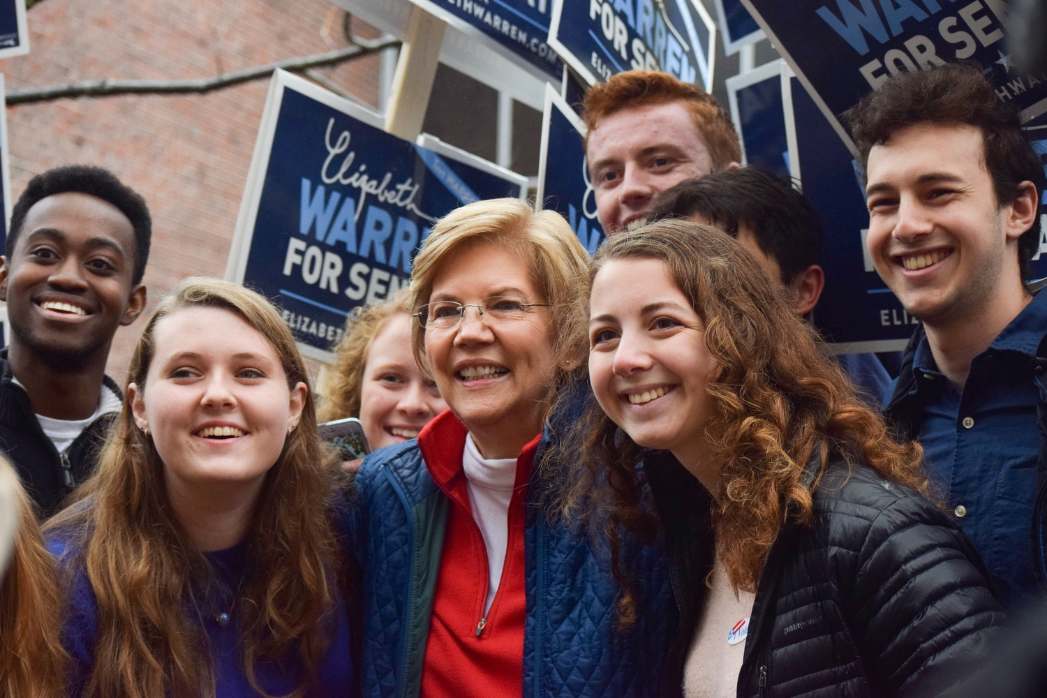U.S. Senator Elizabeth Warren poses for a photo with members of the Harvard College Democrats in November.