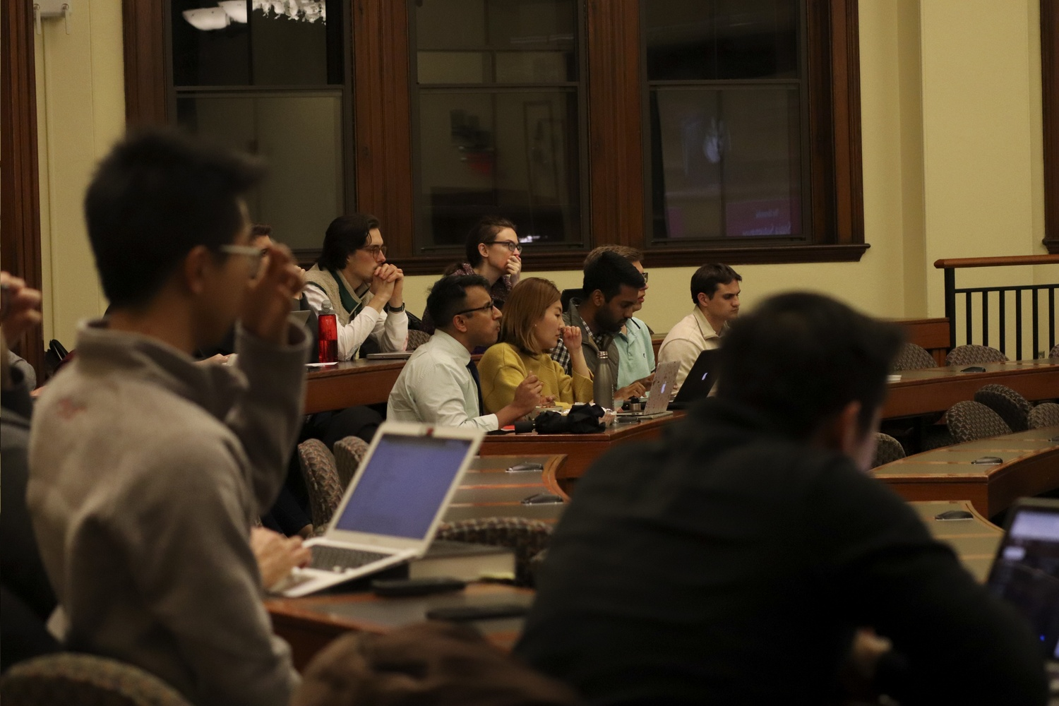 People gather in classrooms on the first floor of Austin Hall Tuesday night to watch a live stream of the final round of the Ames Competition, which was taking place a floor above.
