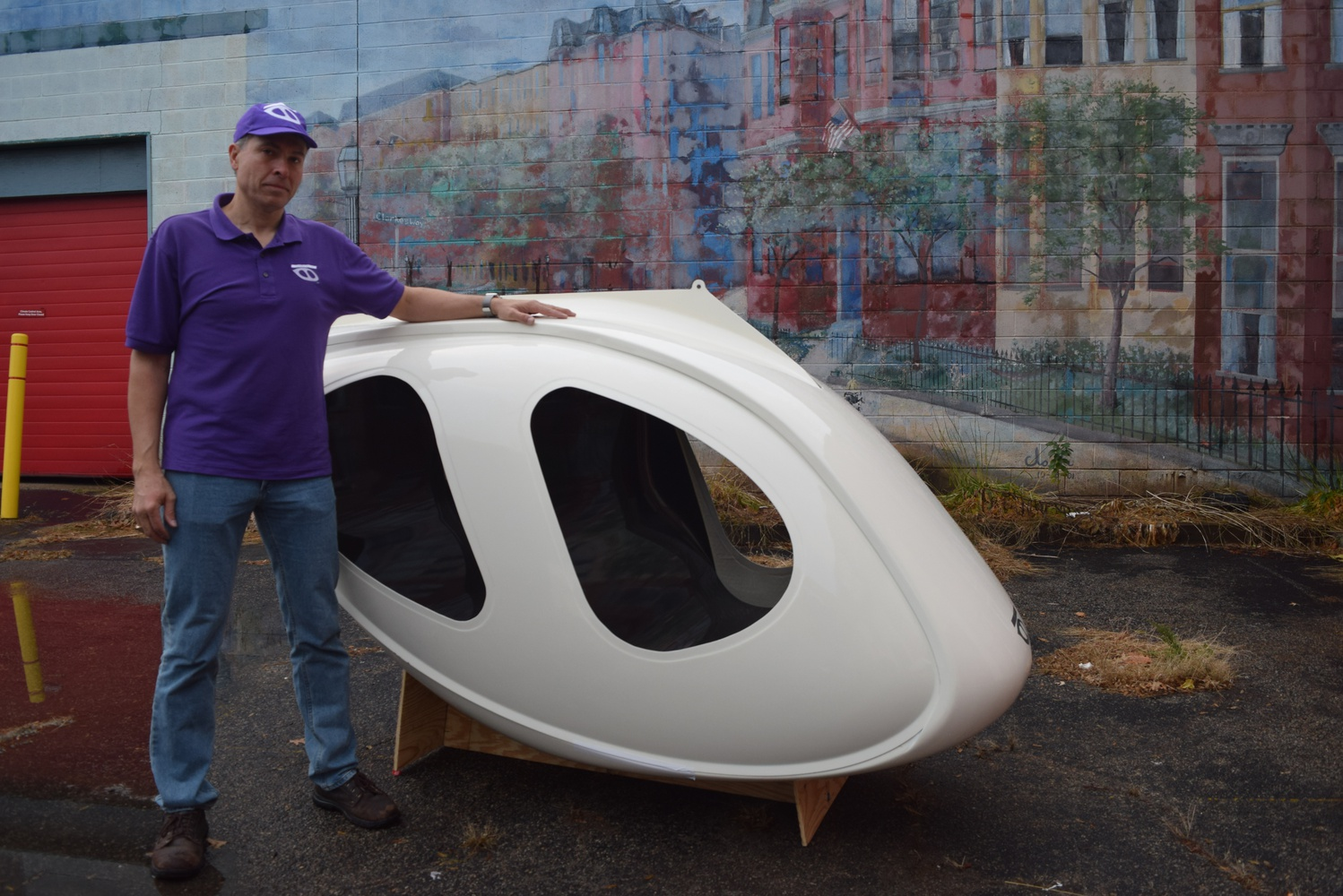 Mike D. Stanley, CEO of Transit X, shows off the pod he hopes will revolutionize public transit.