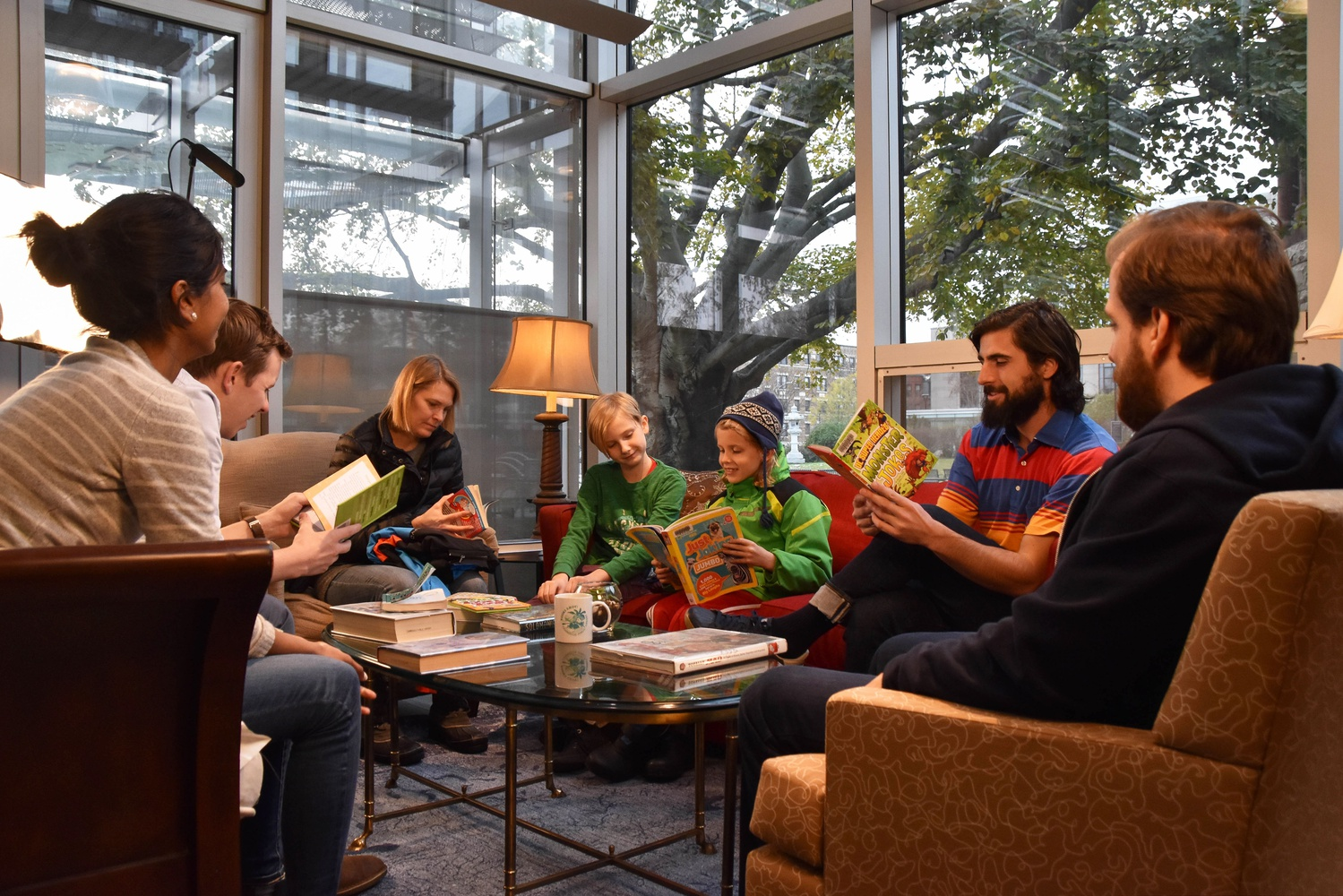 Cambridge residents try out The Laughing Room in the lobby of the Cambridge Public Library.