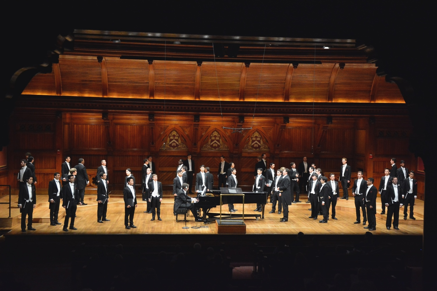 The Harvard Glee Club, one of the Harvard groups formerly directed by Jim Marvin, performs in Sanders Theatre.