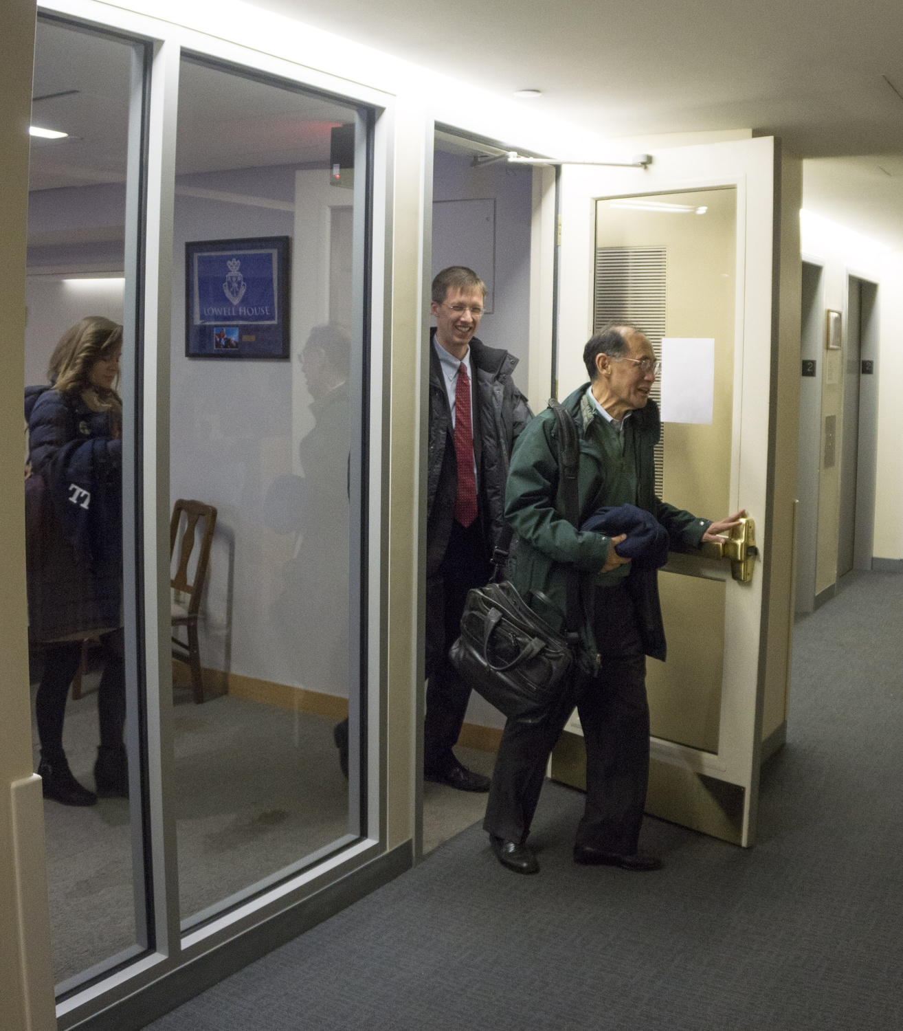 Harvard University Lawyer William F. Lee and Lowell House Tutor and Pre-Law Advisor Sandy Alexander exit the Pechet Room in Lowell House after an hour-long, off-the-record discussion of the admissions lawsuit.