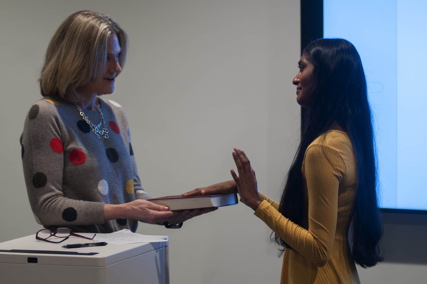 Dean of Students Katherine O'Dair swears in UC President Sruthi Palaniappan '20 using the Harvard book.