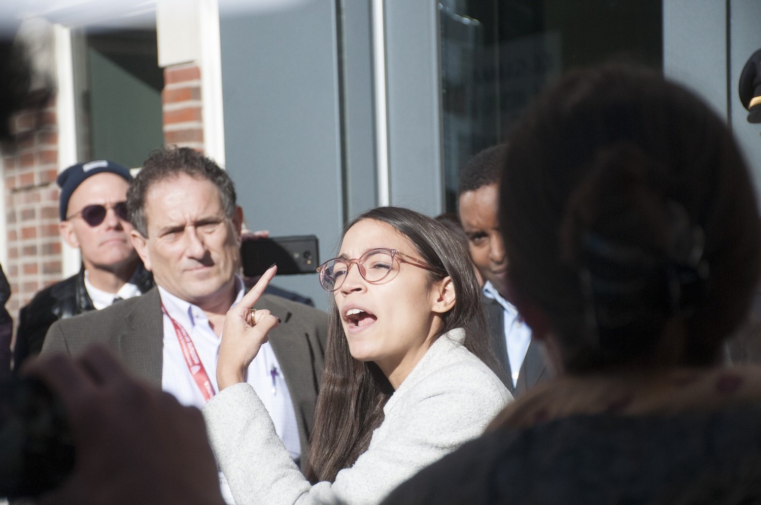 Alexandria Ocasio-Cortez joins a rally to call on the IOP to include environmental justice programming during Harvard's Bipartisan Program for Newly Elected Members of Congress.