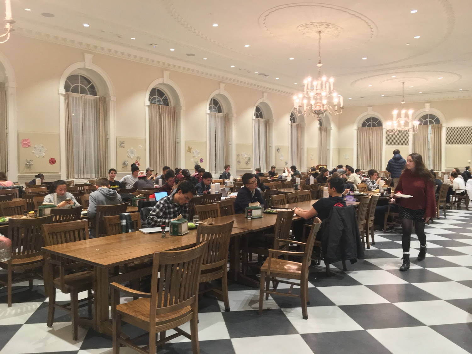 Students work and eat in the Leverett House Dining Hall.