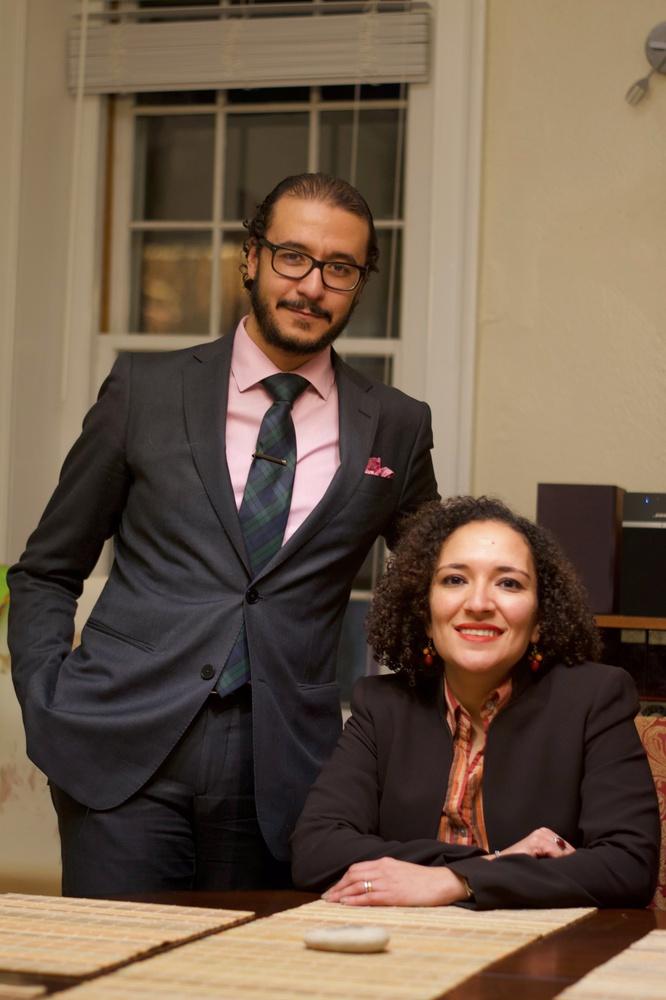 Professor Ahmed Ragab and Professor Soha Bayoumi sit at their dinner table in their Kirkland House home.