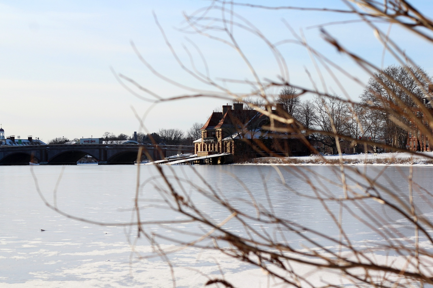 Weld boathouse sits along the frozen Charles River this chilly winter.