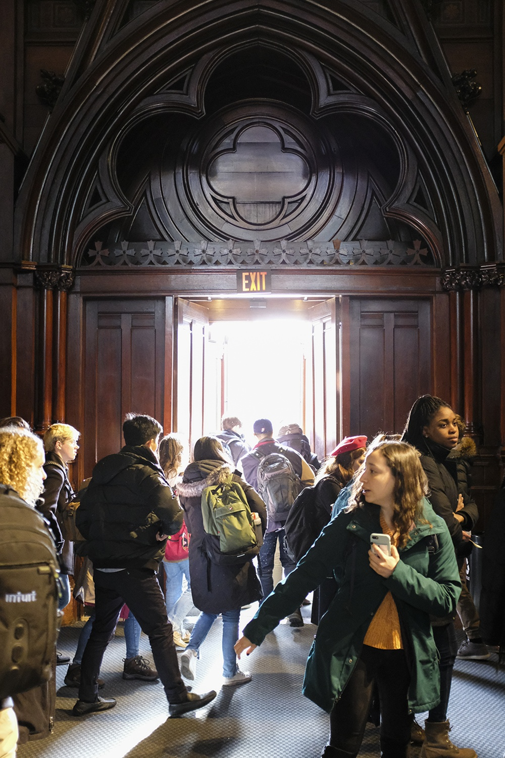 Students file out of Sanders Theater on the first day of Spring classes.