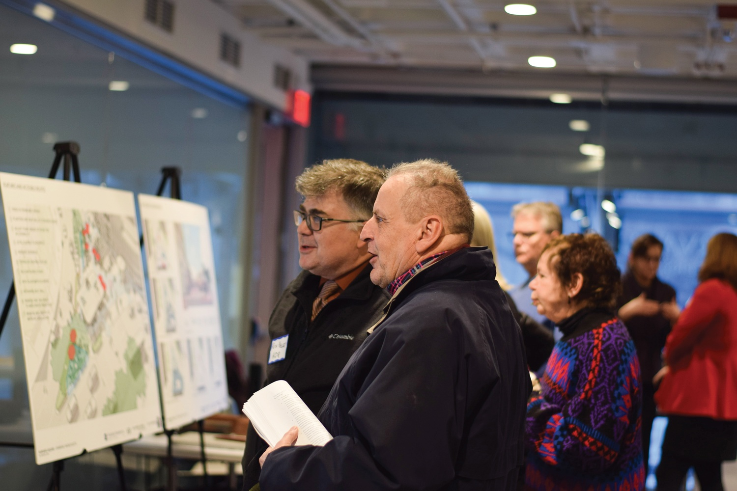 Cambridge residents gathered in the Smith Campus Center Thursday to view preliminary sketches of a redesigned Harvard Square Kiosk. The kiosk has housed a newsstand since 1984.