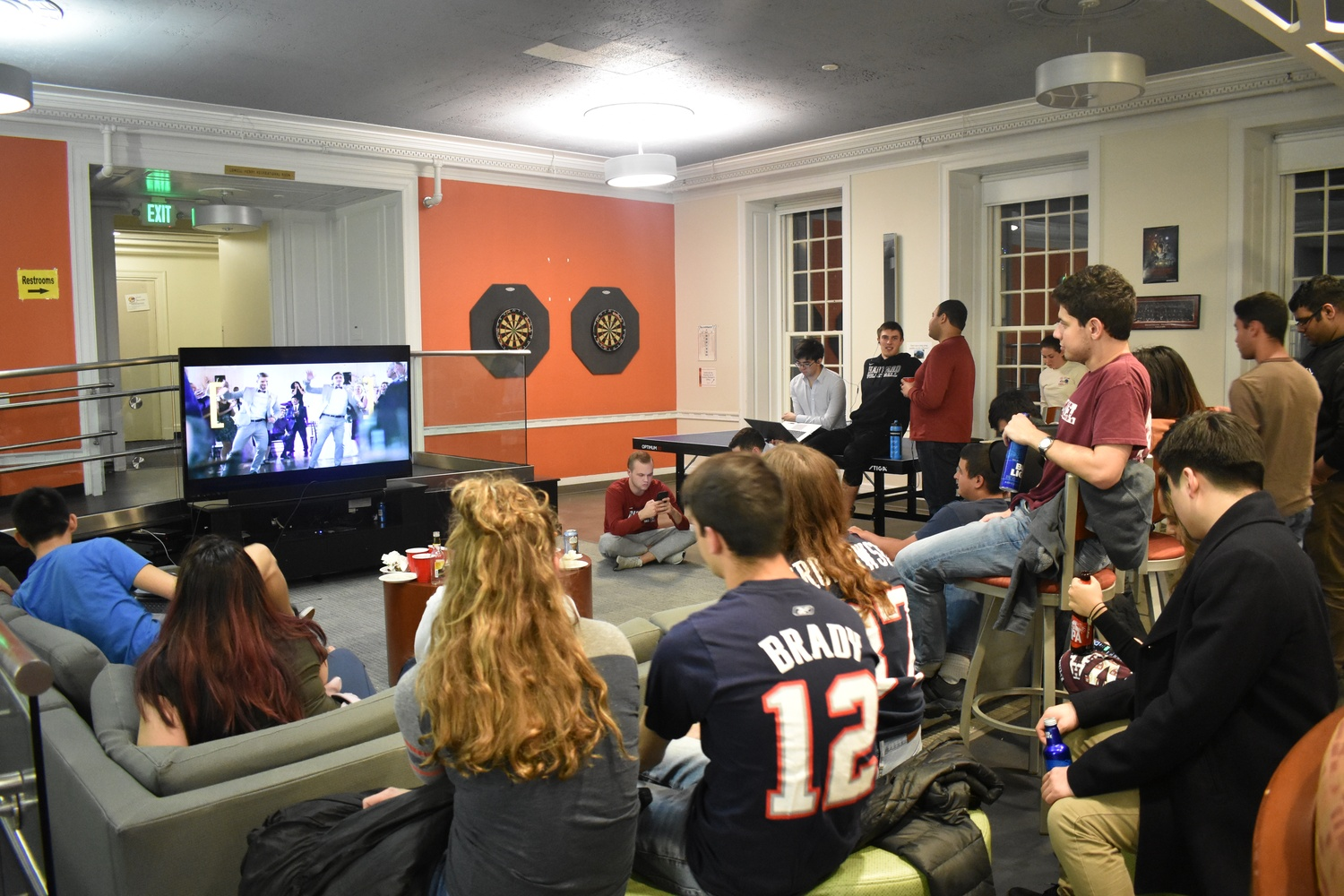 Students watch Super Bowl LIII at a watch party hosted in Pforzheimer House.