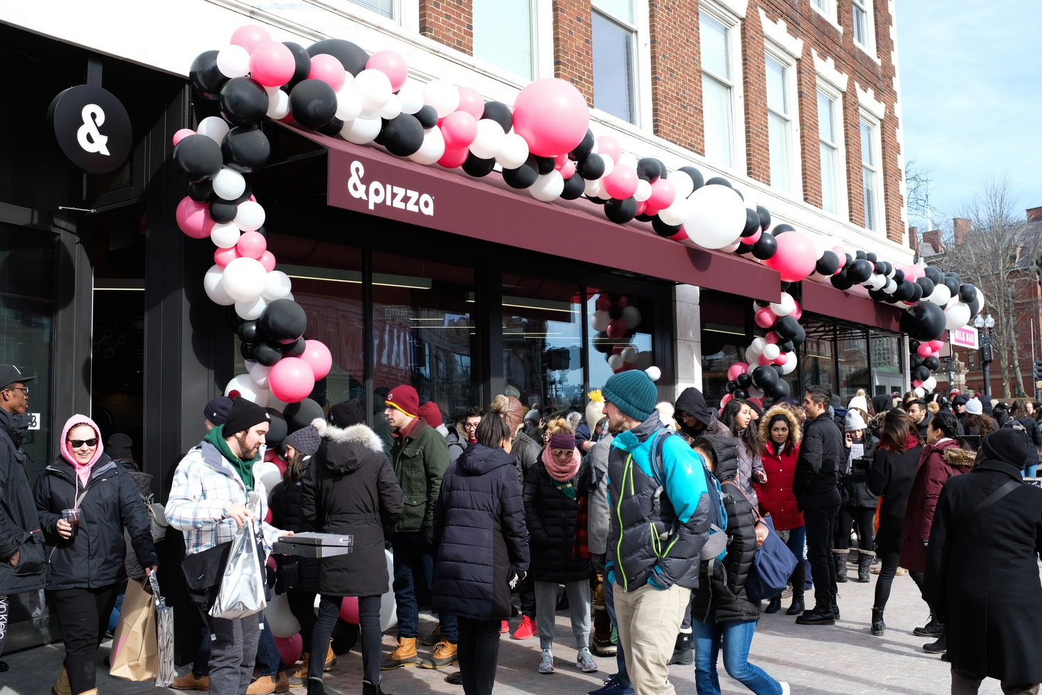Hundreds lined up for the grand opening of Milk Bar and &pizza on Saturday, some waiting for hours to get in.