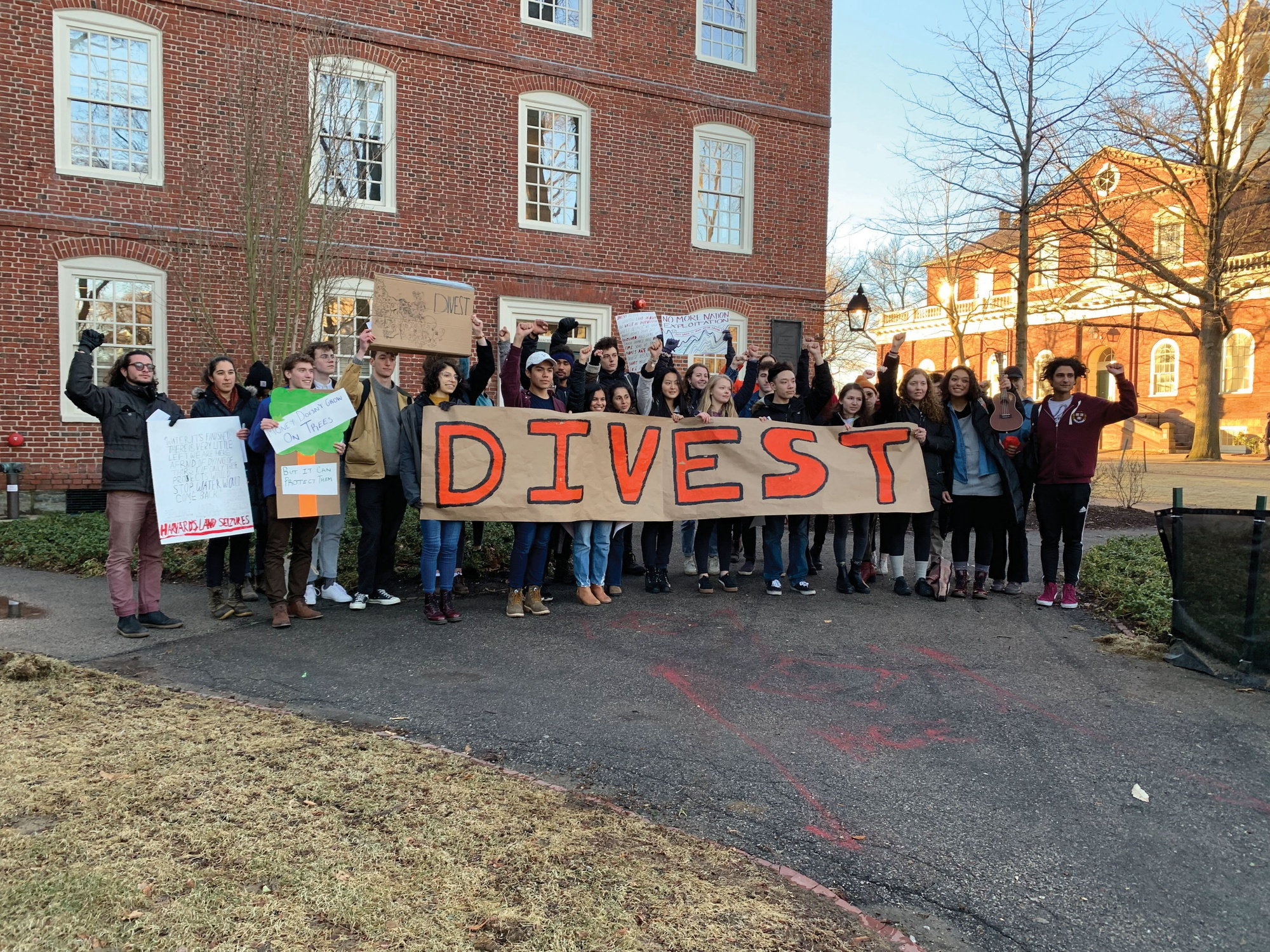 A group of University affiliates marched from Harvard Square to the Yard Friday pushing for administrators to consider divesting from fossil fuels.