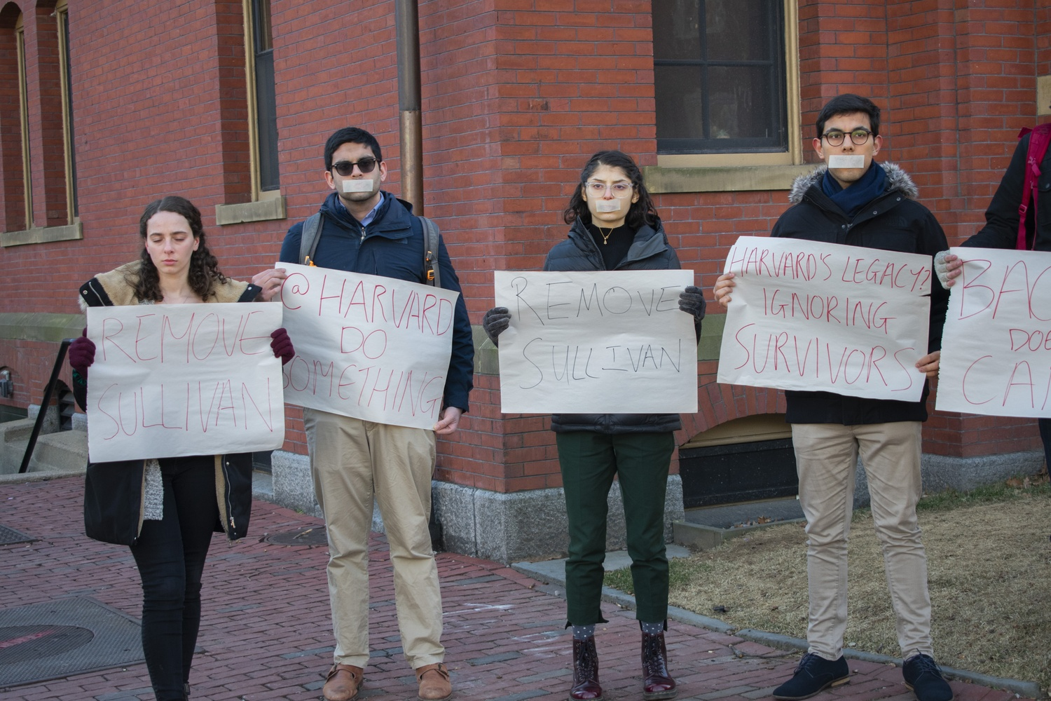 With tape over their mouths in recognition of the #MeToo movement, students demand action from the college following Ron Sullivan's decision to defend Harvey Weinstein.