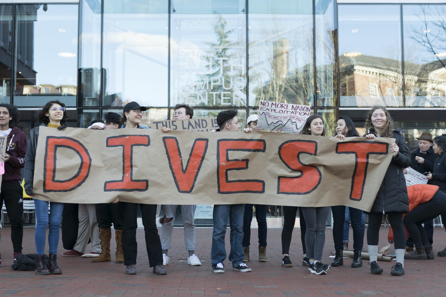 Students gathered in front of the Smith Campus Center earlier this year to protest Harvard's investments in Brazilian and Californian farmlands.