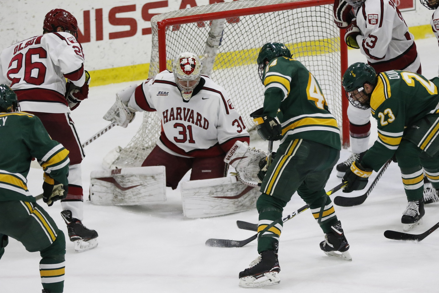 Harvard senior net-minder Michael Lackey left the crease in the game's second period after taking contact on a net-front collision.