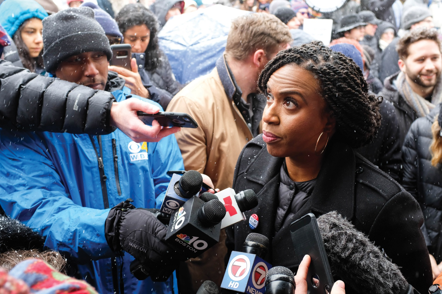 U.S. Representative Ayanna Pressley (D-Mass.) decries President Donald Trump's declaration of a national emergency to build a southern border wall at a protest Monday in Harvard Square.