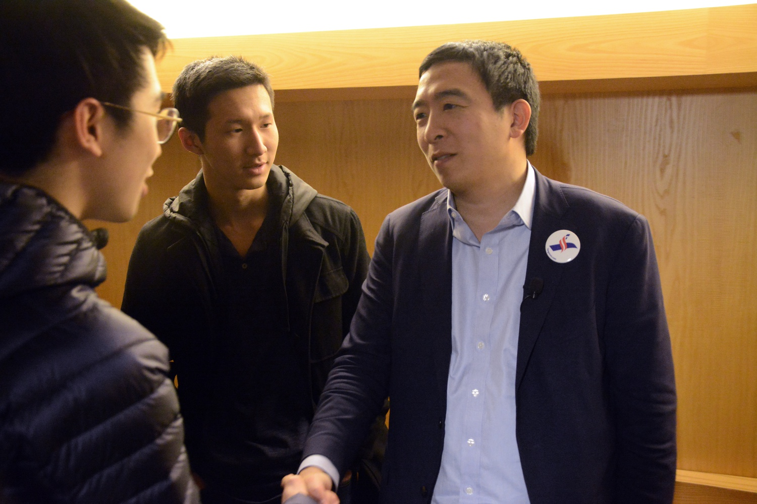 Andrew Yang interacts with Andrew Wang '22 and Ran Bi '22 after the event in Fong Auditorium