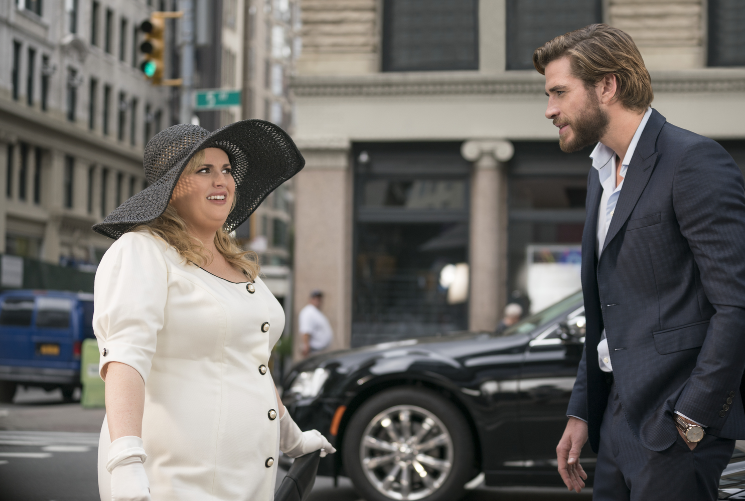 "Rebel Wilson (left) stars as Natalie and Liam Hemsworth (right) stars as Blake in ""Isn't it Romantic"" (2019)."