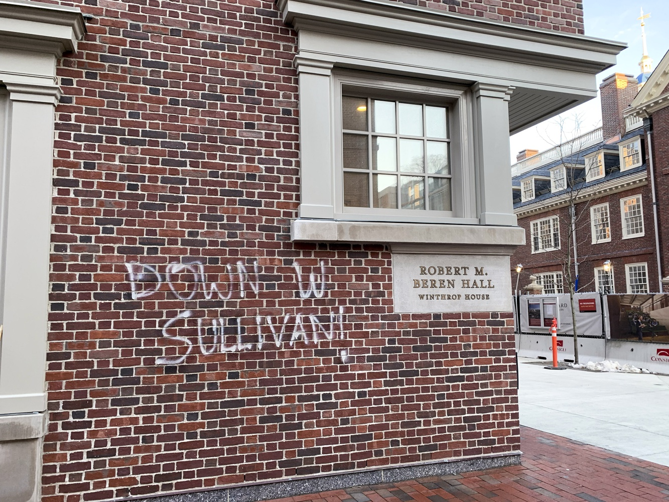 """Multiple """"Down W Sullivan"""" phrases appeared graffitied on Winthrop House Monday morning."""