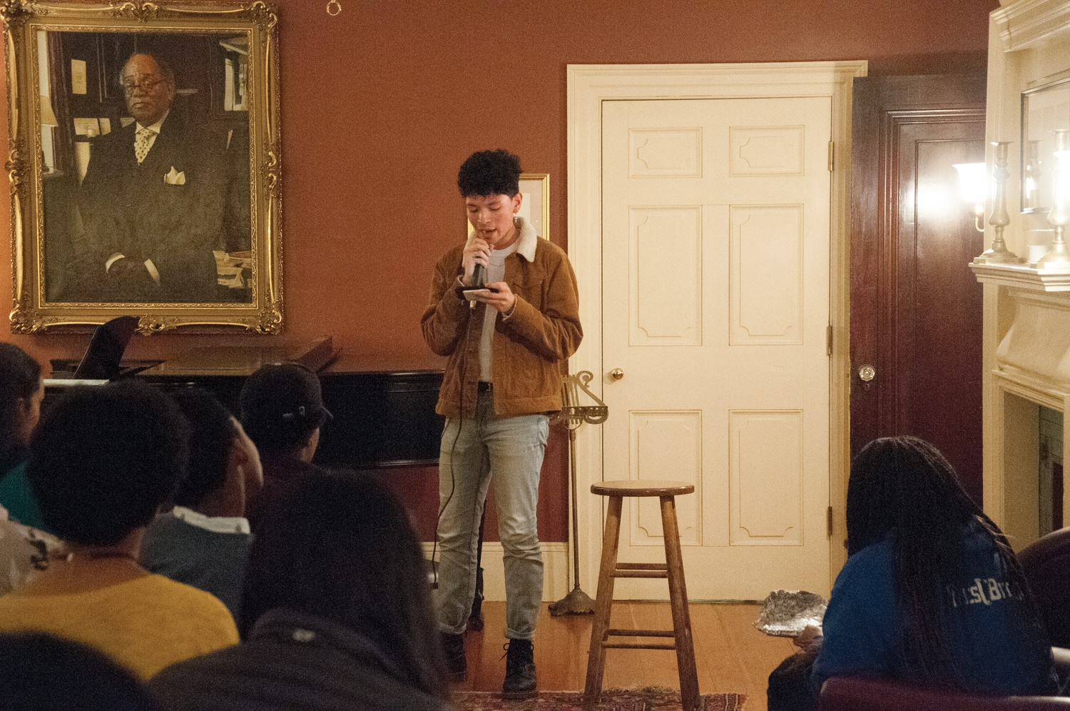 Jesus A. Estrada '22 reads a poem in English and Spanish that narrates a mother-son relationship through gardening work and immigration at the Signet Society Thursday evening. Act On A Dream and other affinity organizations co-hosted an open mic to reflect on immigrant experiences, especially black immigrant experiences, after the arrest of artist 21 Savage.