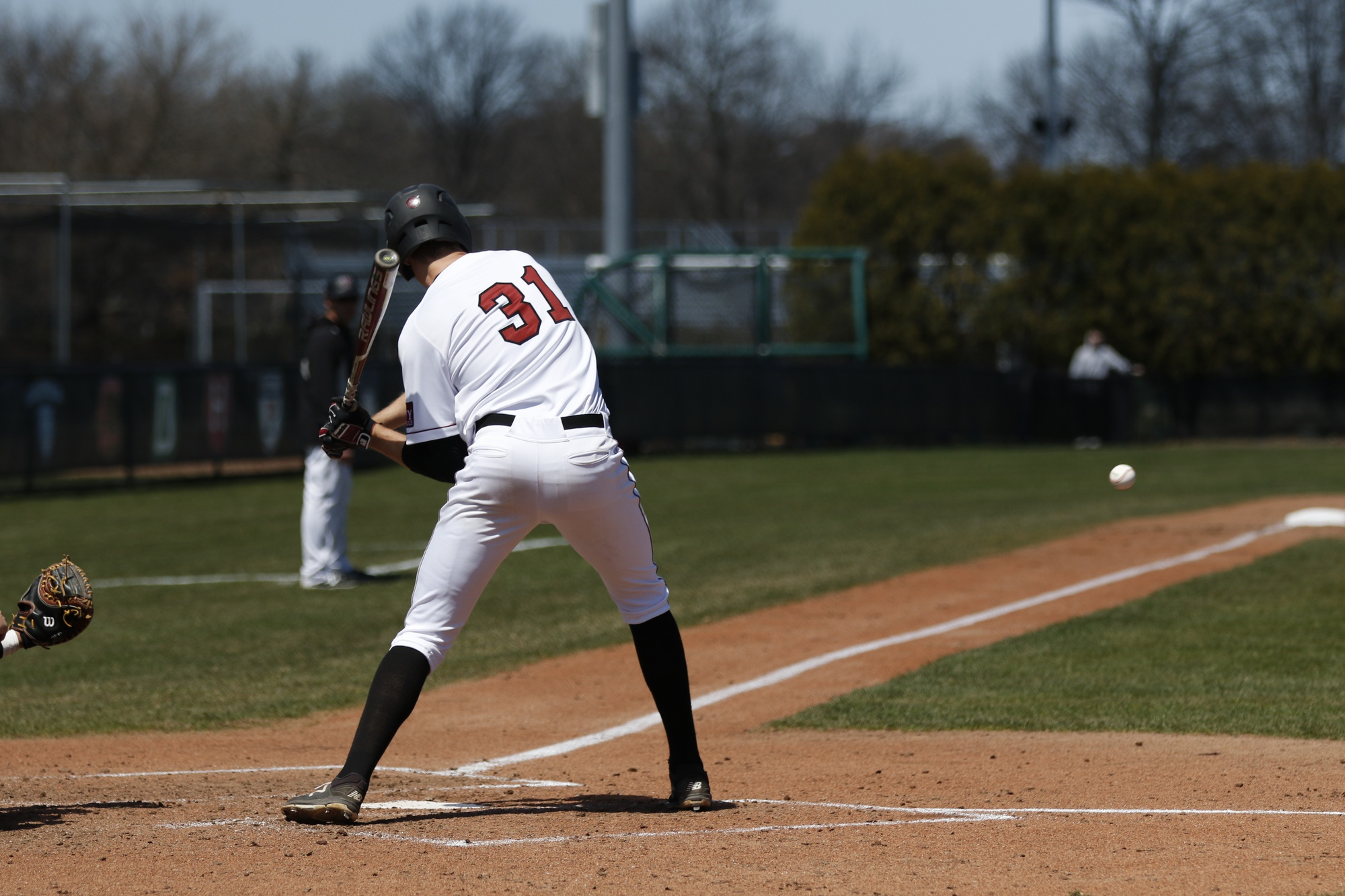 Senior 1B Pat McColl tees off on a pitch in action from last season.