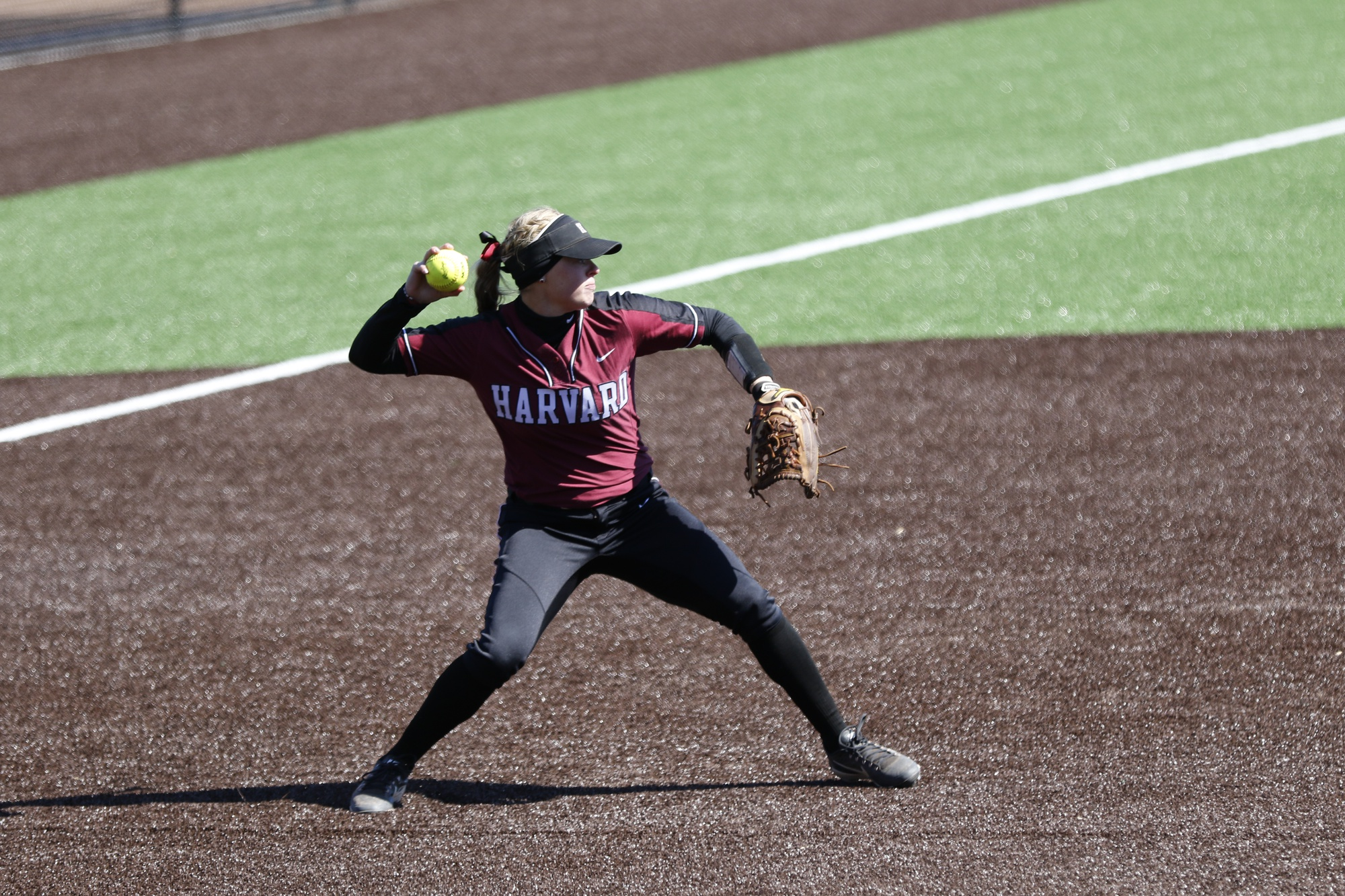 Senior INF Meagan Lantz launches the ball against Yale in a game last season.