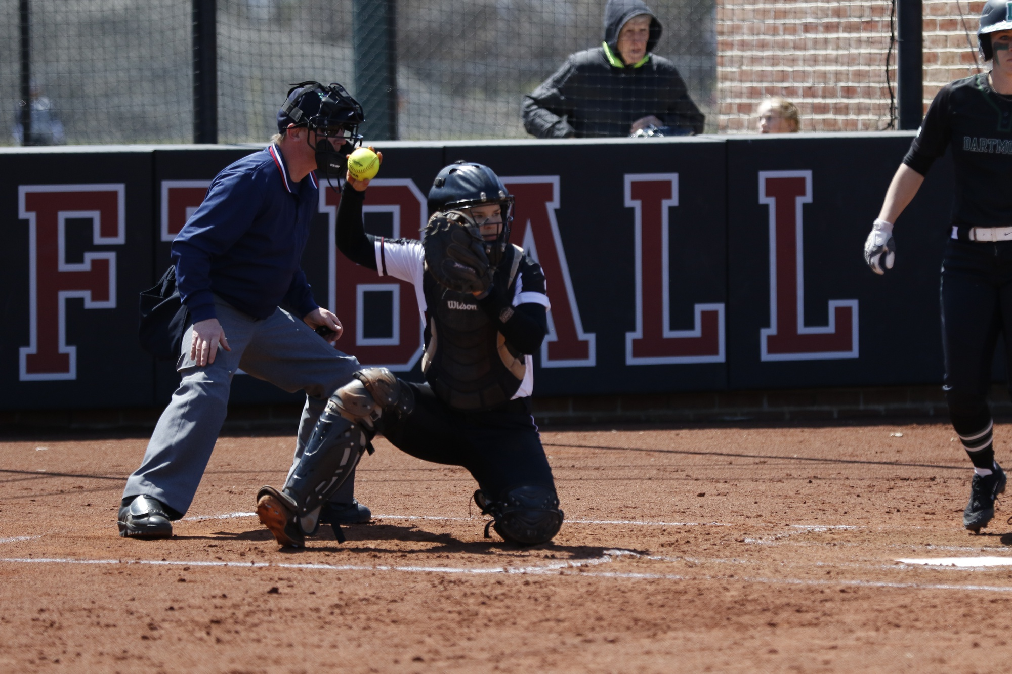 Junior catcher Lindey Knieb tosses the ball back to the pitcher against Dartmouth last April.