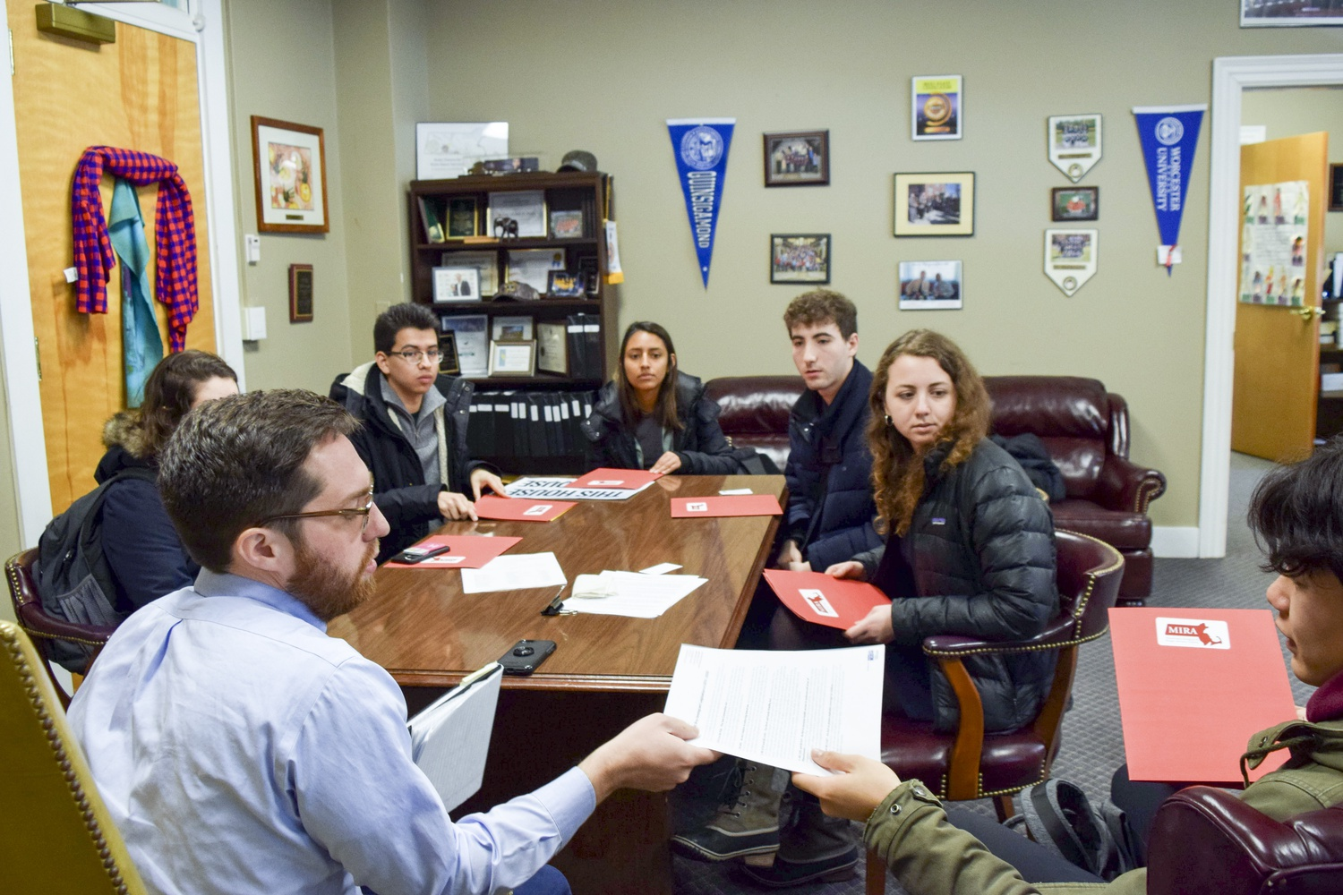 Harvard students visit state legislators at the State House on Monday to lobby for a new Safe Communities Act.
