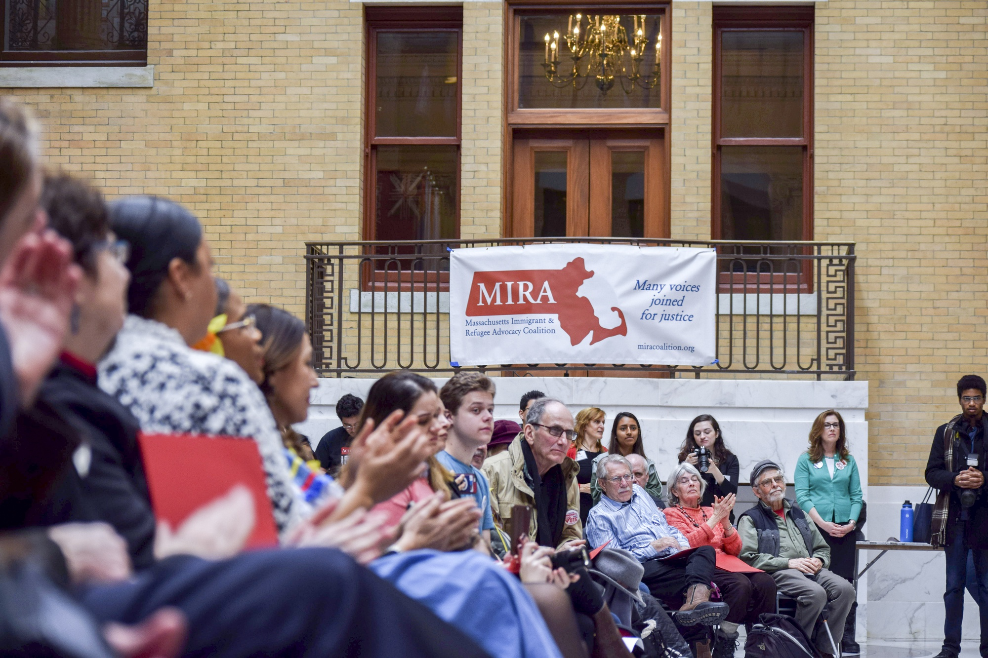A crowd of people attended Immigrants' Day, which was organized by the Massachusetts Immigrant and Refugee Advocacy Coalition.