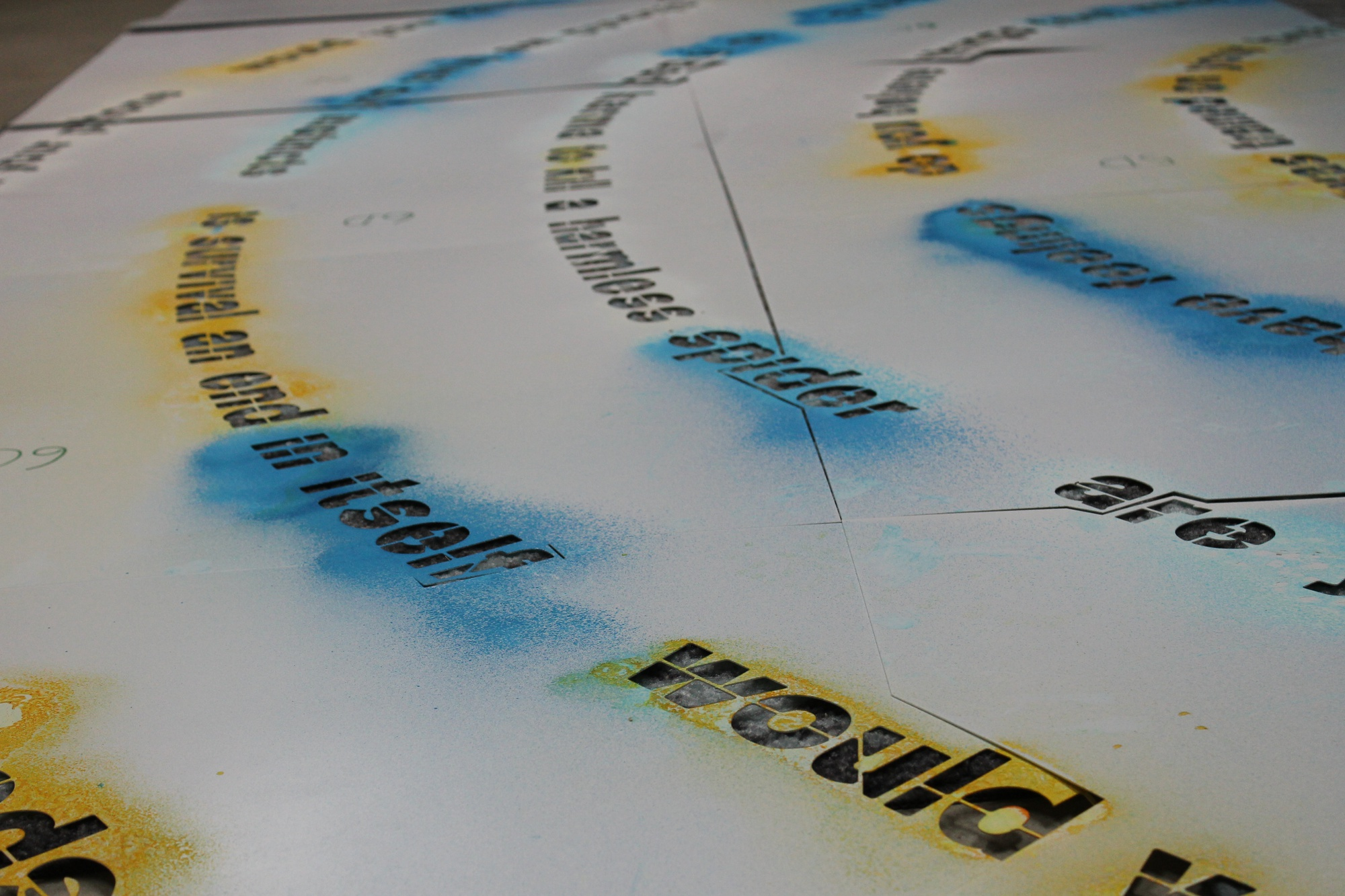 Sarah Newman has worked on multiple versions of the Moral Labyrinth, using varied mediums including blue and yellow spray chalk, sticky vinyl, and baking powder.