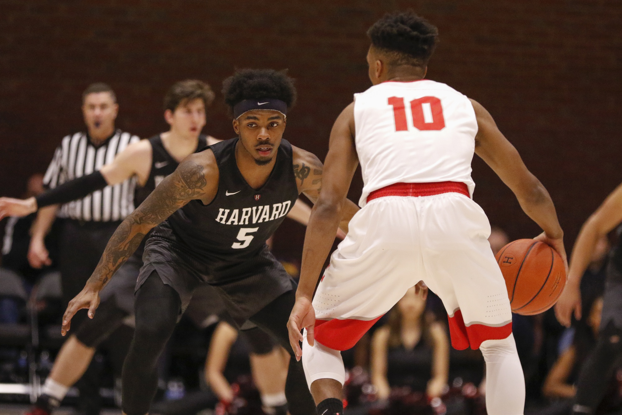 Sophomore guard Rio Haskett guards Matt Morgan in the first contest between Harvard and Cornell.