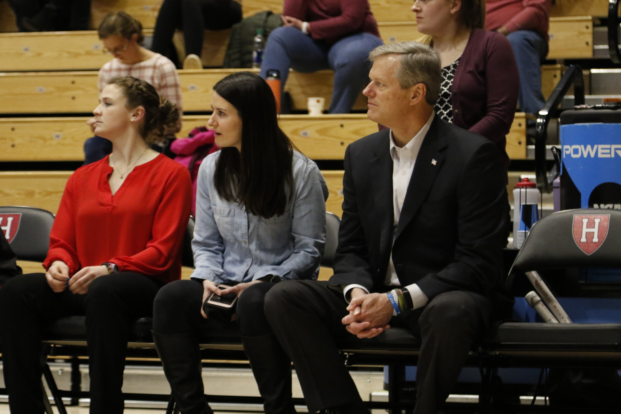 Governor Charlie Baker looks on as Harvard defeats Columbia on senior night.