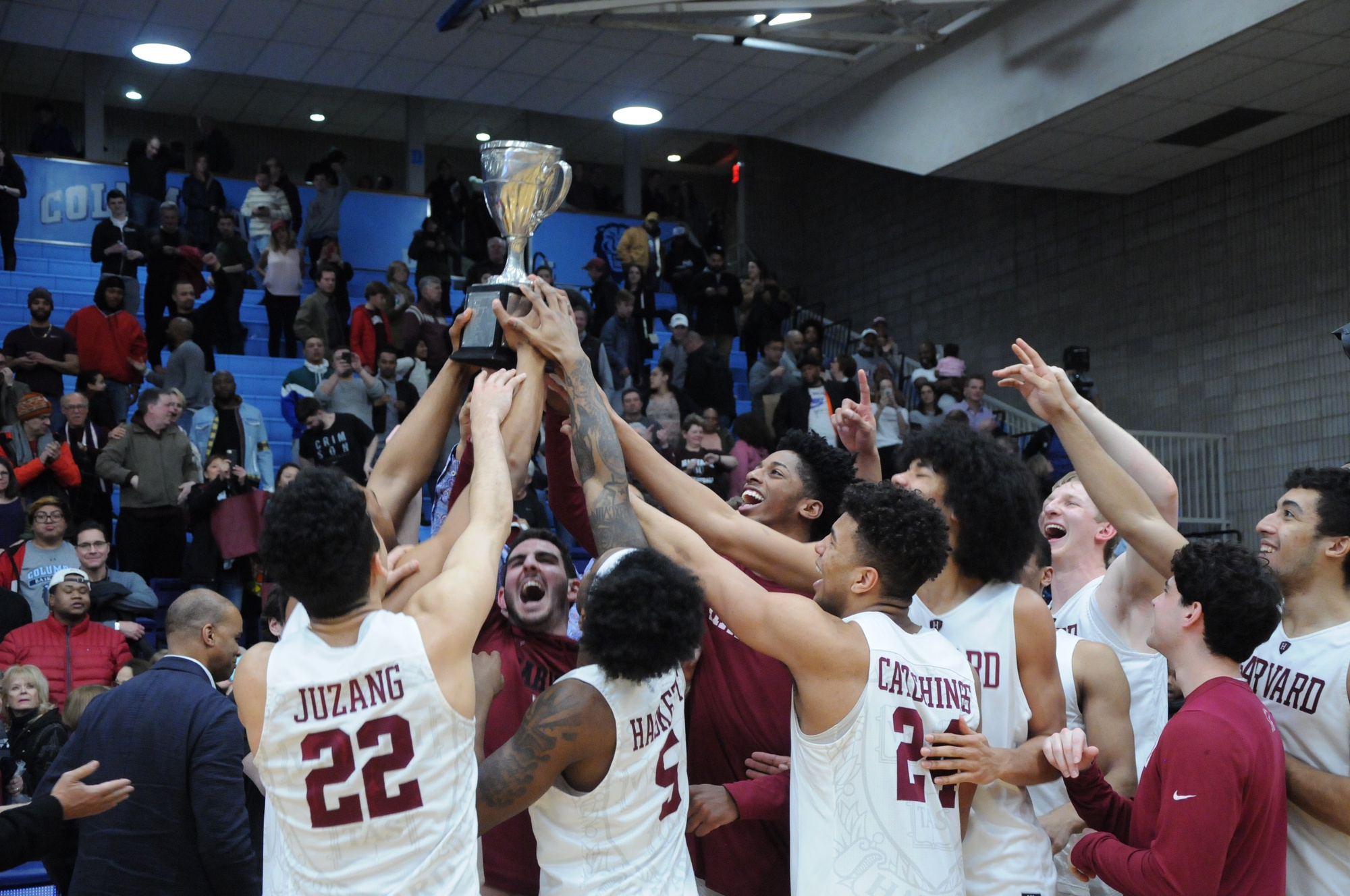 The Harvard men's basketball team earned its seventh Ivy League regular season title with a 83-81 victory over Columbia.