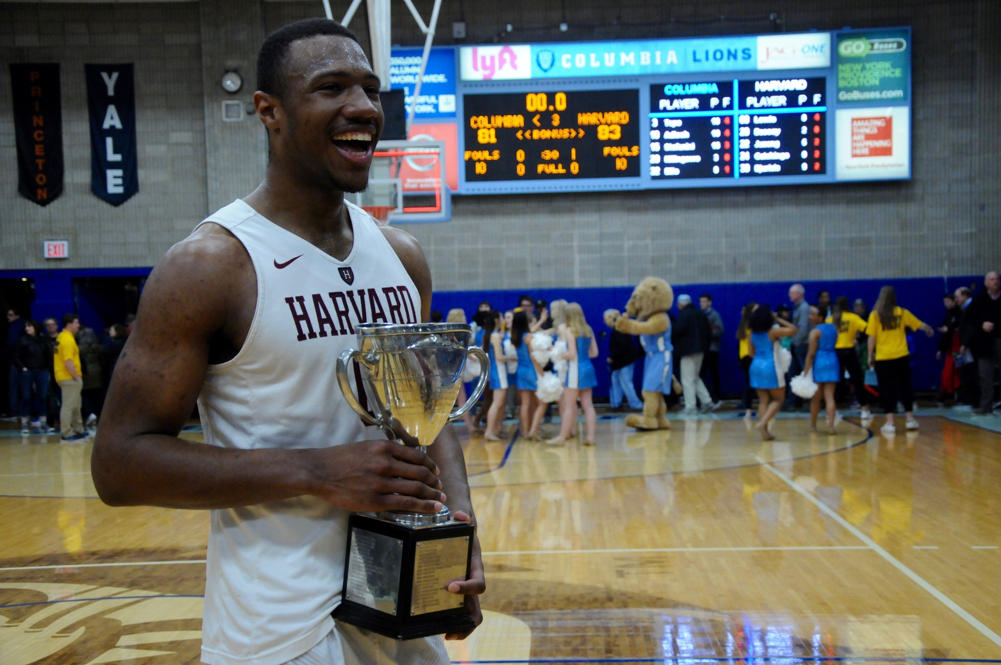Junior big Chris Lewis was all smiles as he held the championship trophy.