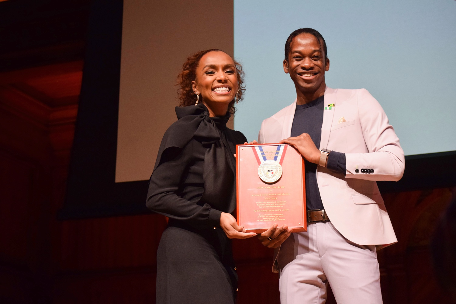 Journalist and activist Janet Mock received the Harvard Foundation's 2019 Artist of the Year award from Cultural Rhythms director Hakeem O. I. Angulu '20.