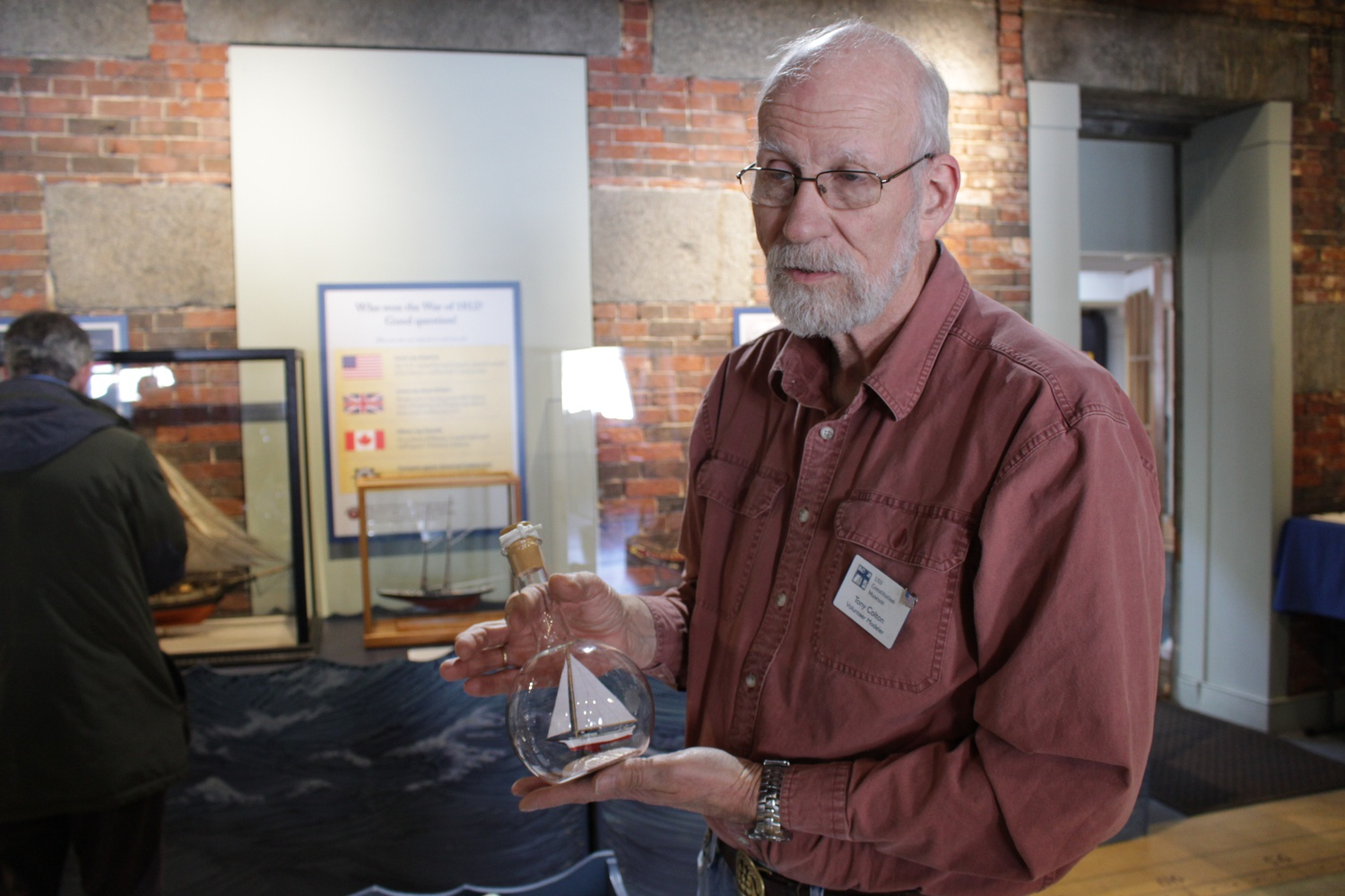Anthony J. Colton showcases his model ship in a bottle of the Carrie Price, a boat from Maryland in 1897, at the Masters of Miniature: 40th Annual Model Ship Show.