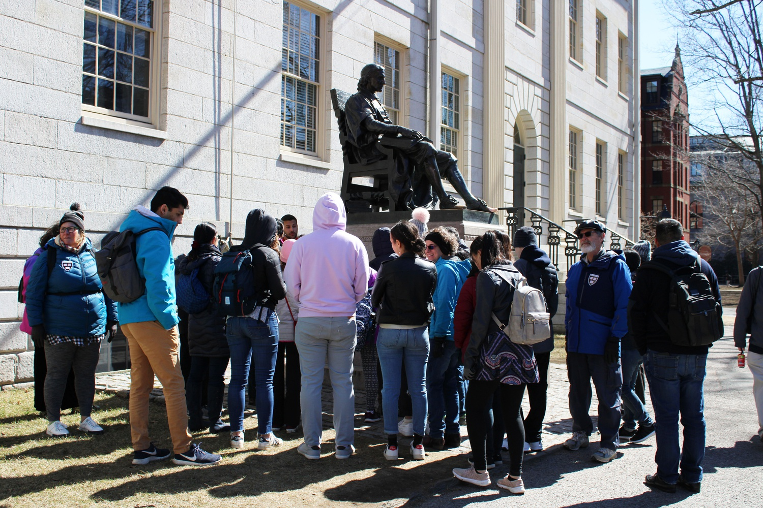 As winter ends, and the climate improves for outdoor activities, the size of tour groups around Harvard increase in number. The campus attracts curious tourists and prospective college applicants.