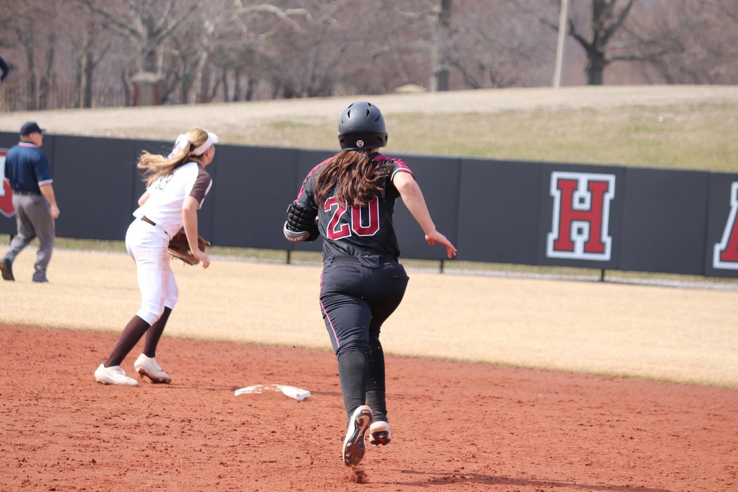 Senior INF Erin Lockhart dashes towards second base.