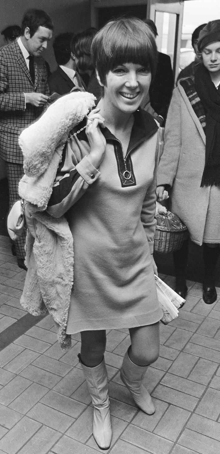 In the early 1960s, Mary Quant took the place of Jackie O as fashion icon, replacing kitten heels with mini skirts. This is just one example of the changes sweeping pop culture in 1964.