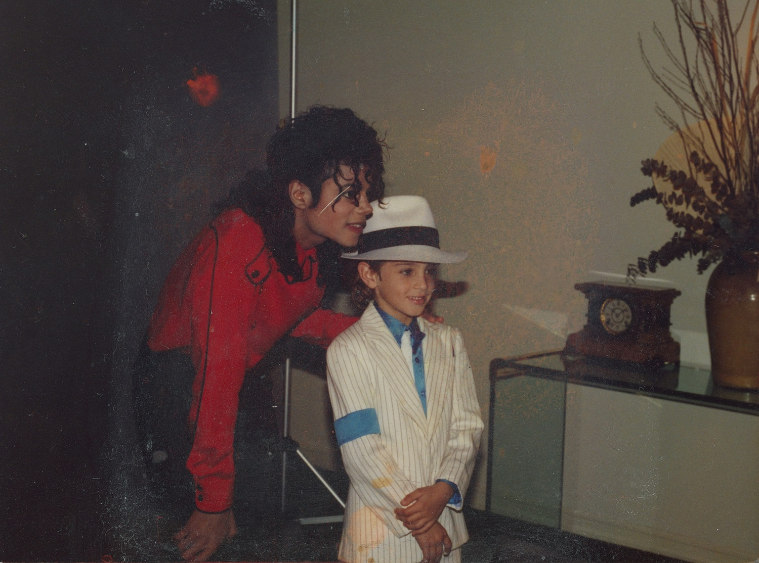Michael Jackson and Wade Robson posing for a photo.