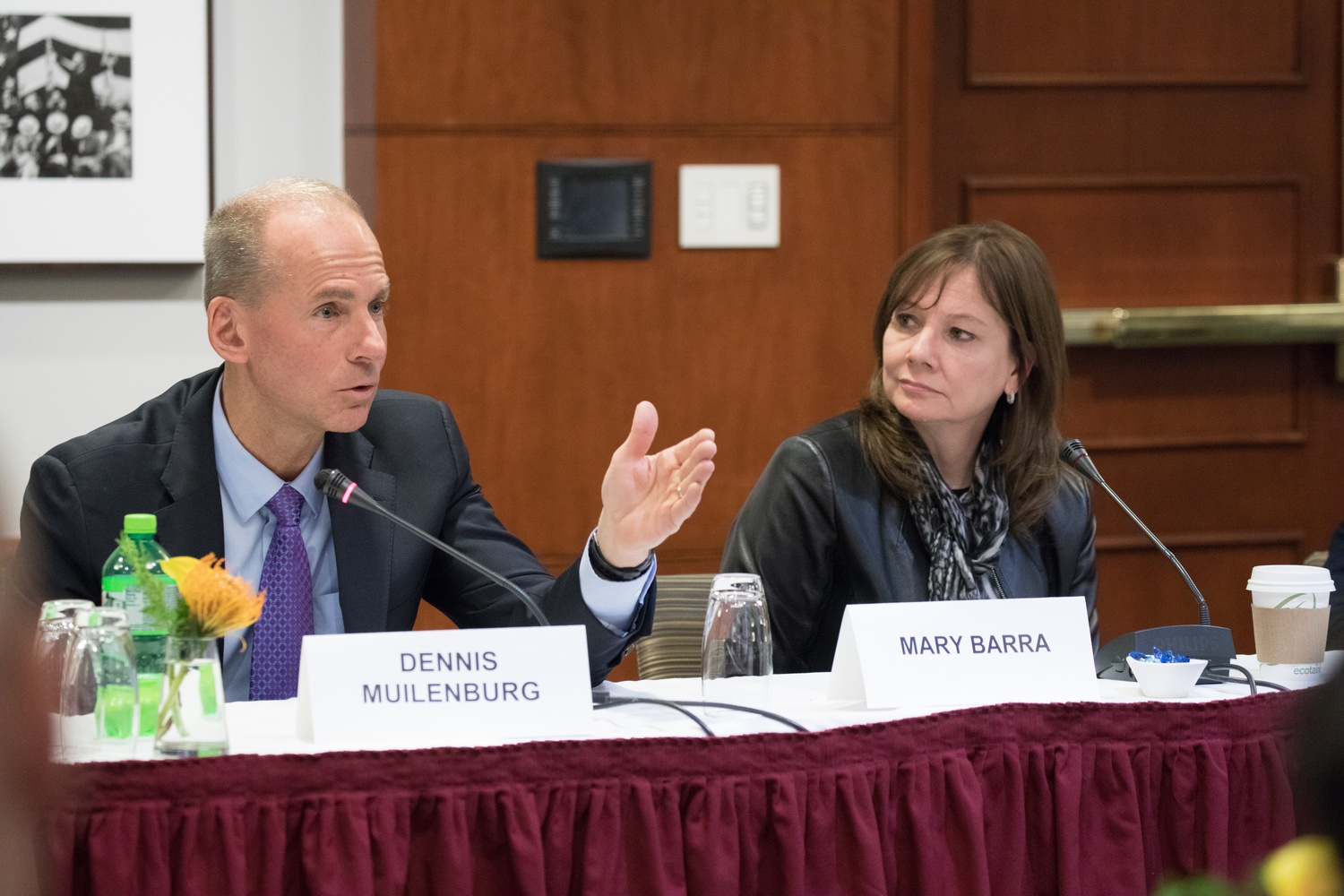 Boeing CEO Dennis A. Muilenburg (left) and General Motors CEO Mary T. Barra (right) speak to new members of Congress in a panel on business.