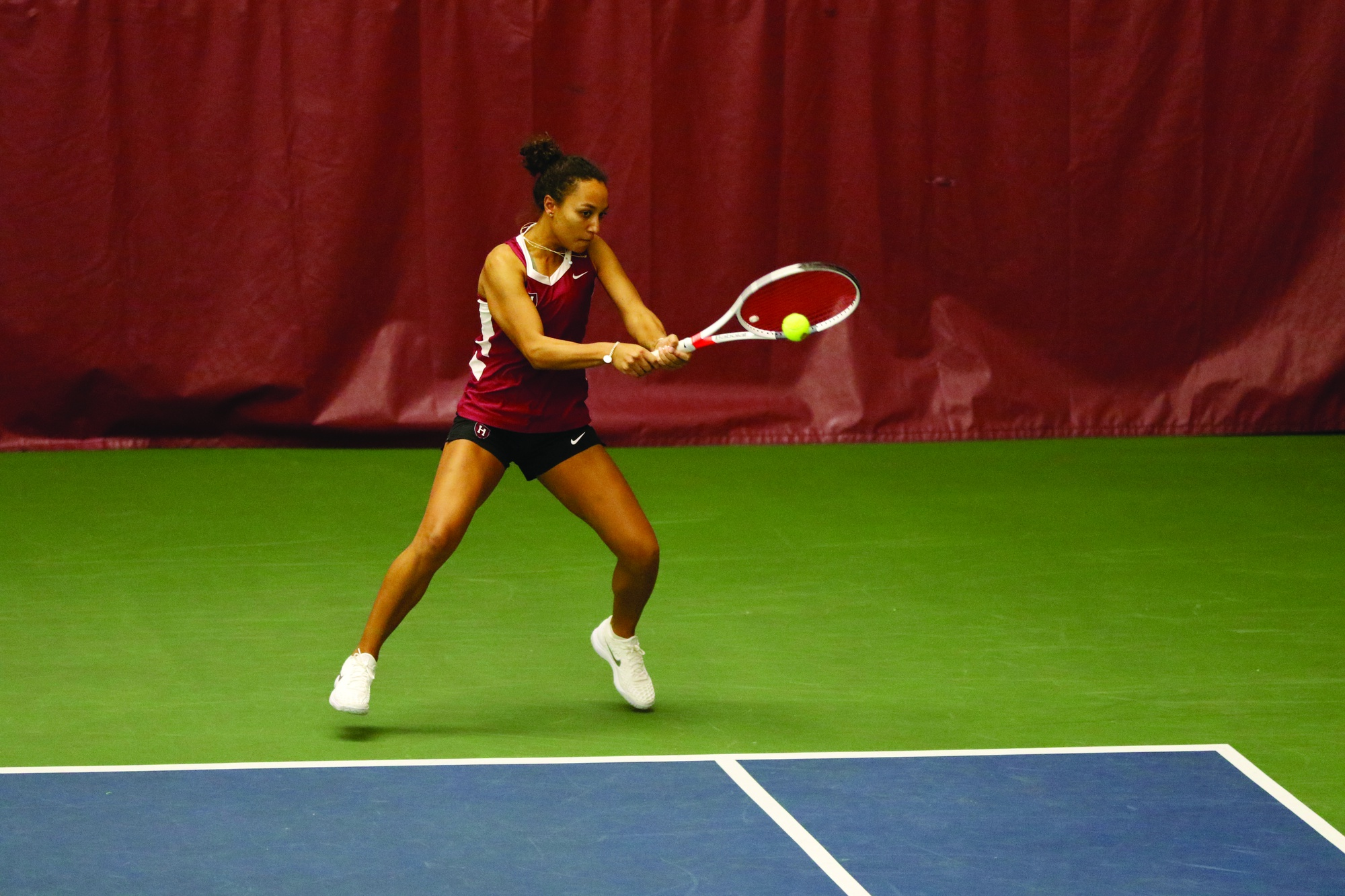 Senior Erica Oosterhout tracks a backhand at the baseline. Oosterhout is playing from the Crimson's No. 1 singles position this year. She was a unanimous All-Ivy First Team selection in singles play last season, a feat that she will aim to match in her final season playing on the Murr Center courts.