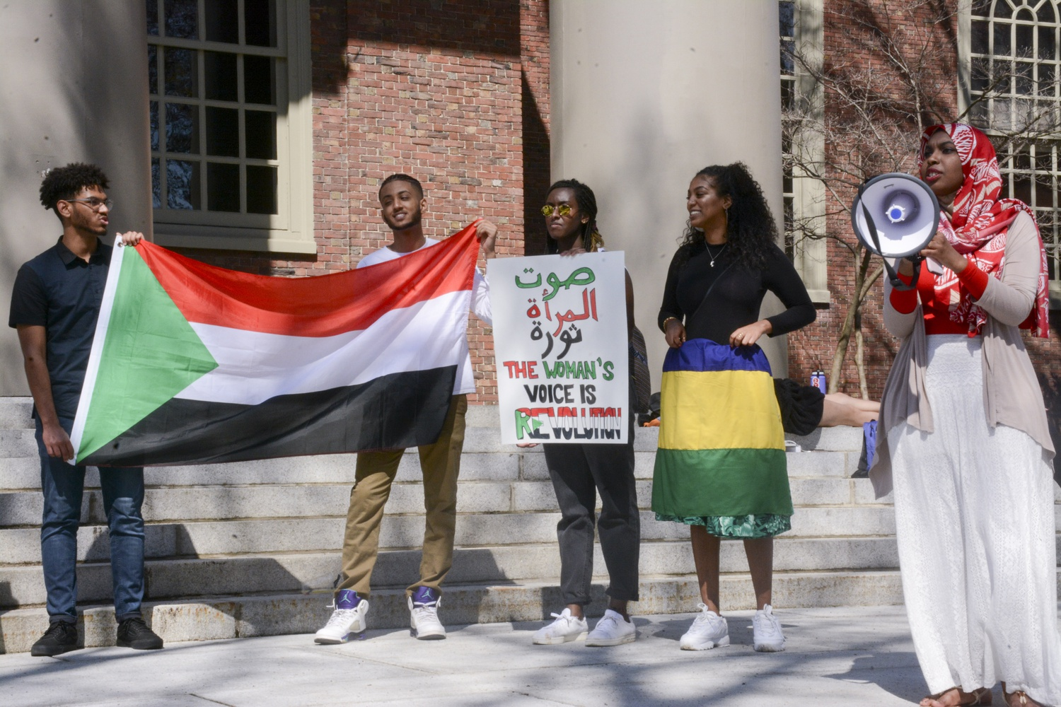 Sudanese students protest in support of democratic governance in Sudan on the steps of Memorial Church on Saturday afternoon. Days before, Omar al-Bashir, the dictator of thirty years, was ousted in a military coup.