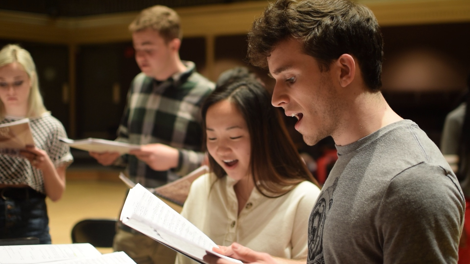 """Nico P. Barlos '22 and Odessa X. Deng '22 play a young couple embroiled in chaos aboard a flight to London in """"Cruising Altitude,"""" this year's First-Year Musical."""