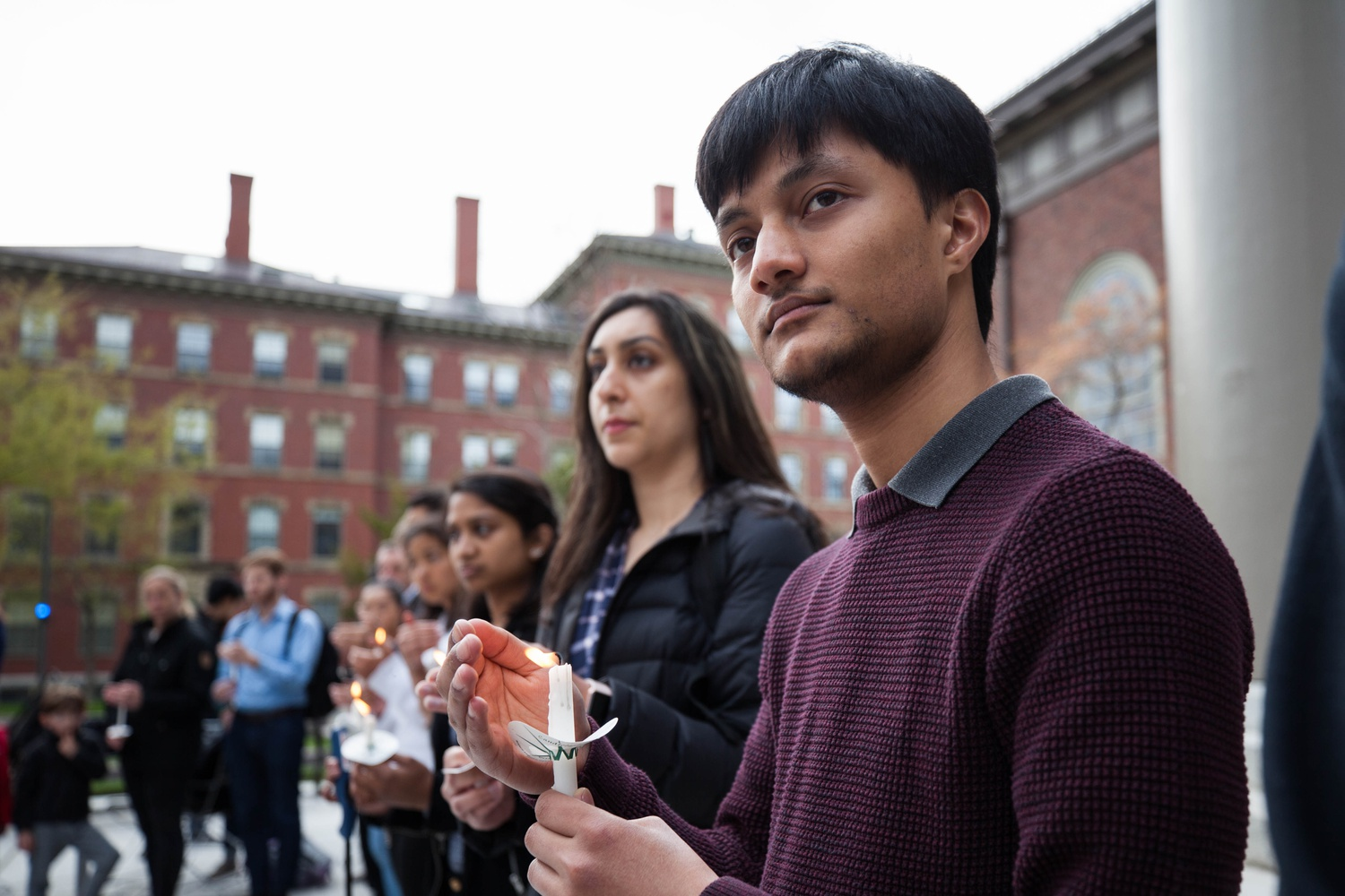 Satish Wasti '21 takes part in a Prayer Vigil on the steps of Memorial Church hosted by several student groups in light of the recent terrorist attacks in Sri Lanka.