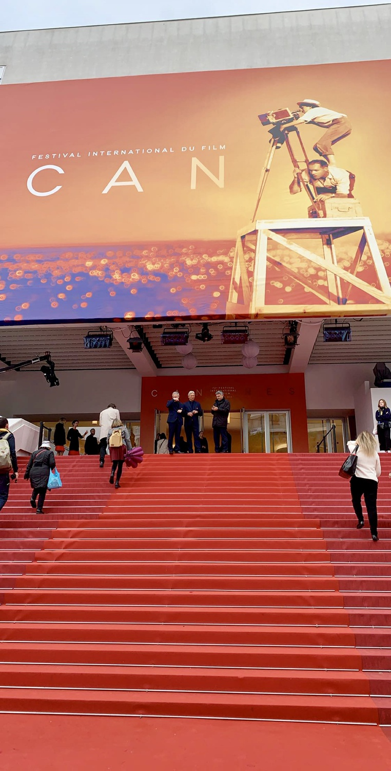 The red carpet staircase leading up to Grand Theatre Lumière, the largest and most glamorous theater at Cannes where Competition films officially premiere, usually with the crew and cast in attendance.