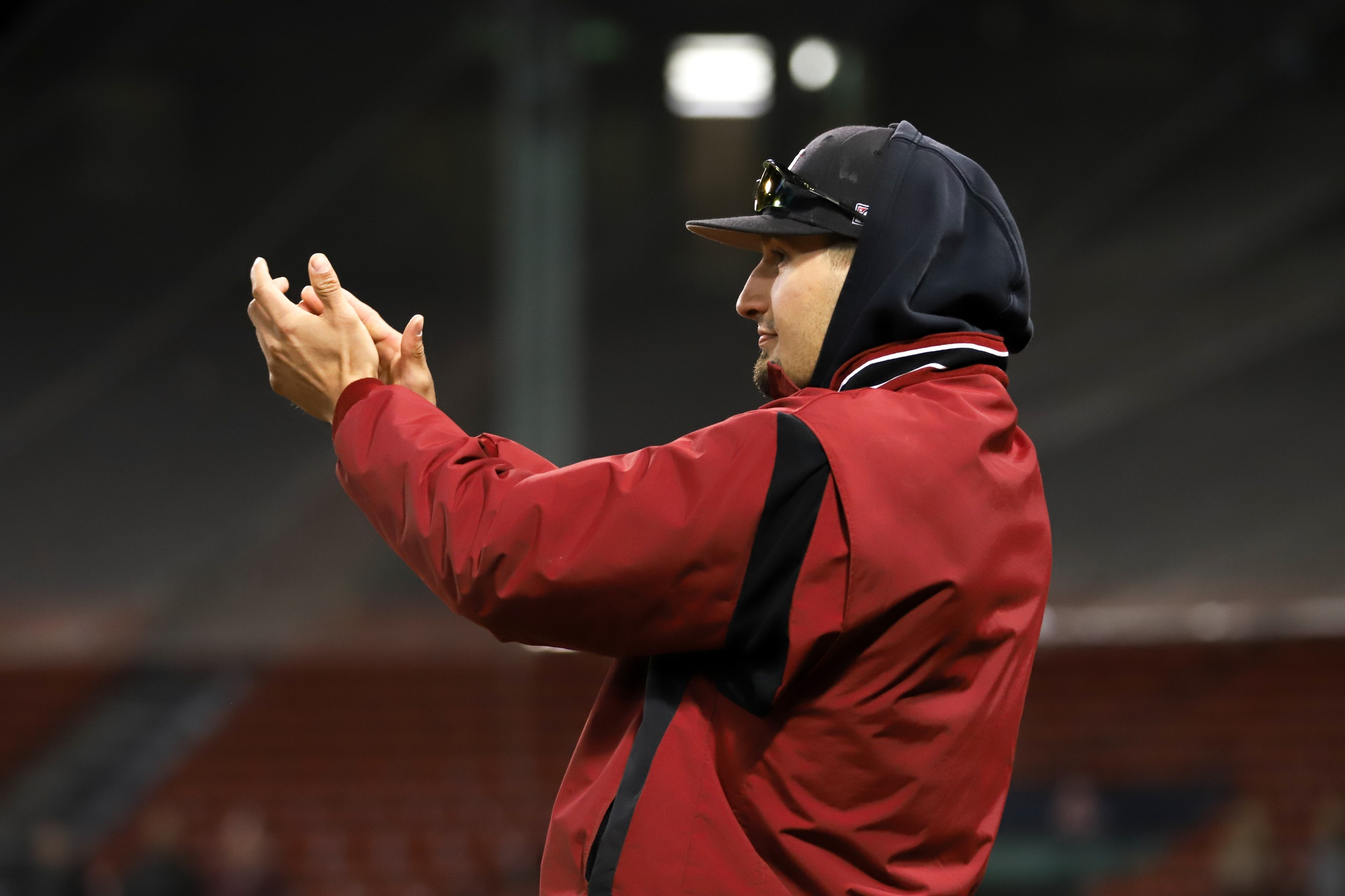 Senior pitcher Kevin Stone cheers from the dugout of this season's Beanpot Championship at Fenway Park.