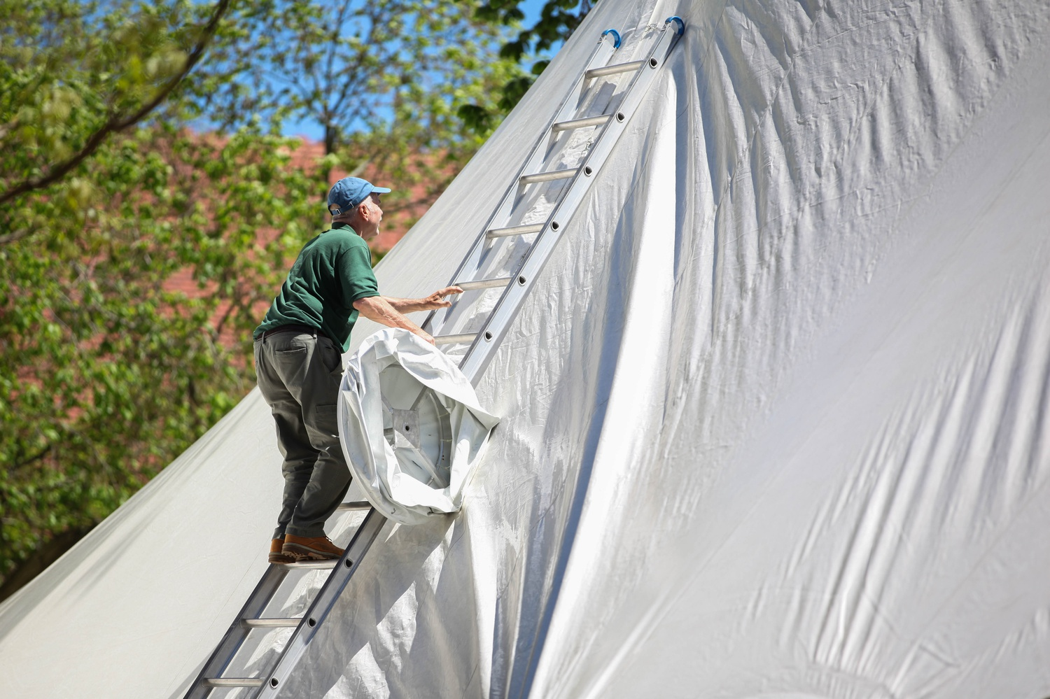In preparation for Commencement, contracted employees from the William Blanchard Company install a tent in Tercentenary Theatre.
