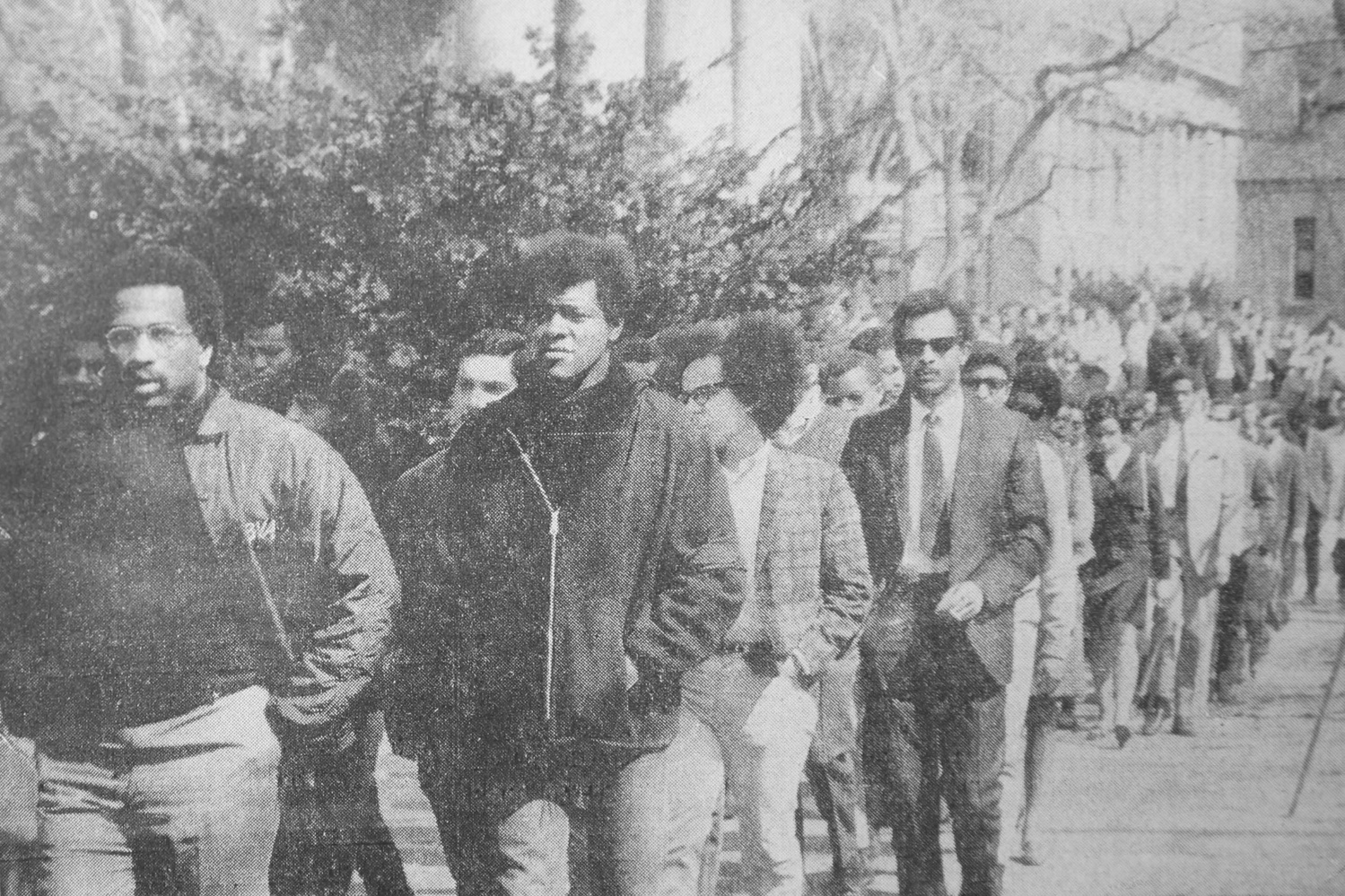 Black students leave a University memorial service for Rev. Martin Luther King Jr. to attend a separate service.